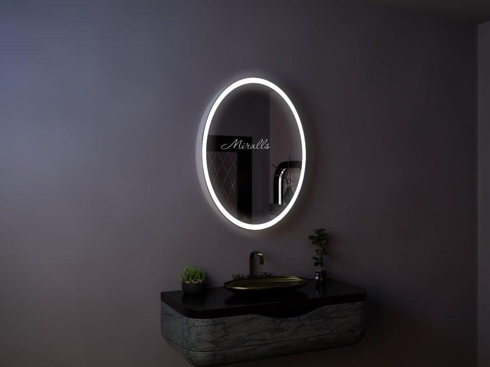 овальный зеркальный шкаф для ванны Ostin с интерьерной и фронтальной подсветкой